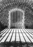 Winery entry doors, black and white. Black and white, Napa Valley Winery, elaborate doors and arched entry arbor royalty free stock image