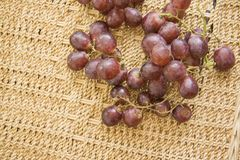 Winery grapes on rattan background Royalty Free Stock Images
