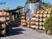 Winery storage. Huge wine vats and wooden barrels at a winery Royalty Free Stock Photo