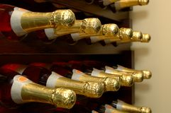 Winery-Wine Bottles. Rows of bottled wine in a winery. Focus = 2nd bottles from the left. 12MP camera Royalty Free Stock Images