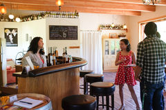 Winery worker serves visitors at Oregon vineyard Stock Image