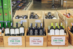 Wines in glass bottles from many countries in wooden crates for Stock Images
