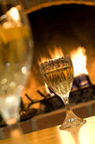 Wines glasses by open fire Royalty Free Stock Photography