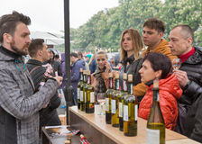 Wines of Kyiv Food and Wine Festival in Kiev, Ukraine. People visit booth of Ukrainian winery Inkerman on Kyiv Food and Wine Festival in National Expocenter, a Stock Photos