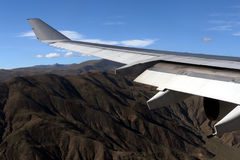 Wing. Of flying airplane above the mountains Royalty Free Stock Images