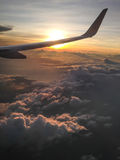 Wing of aeroplane and sunset in evening silhouette style Stock Photography