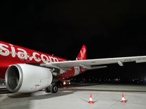 Wing of AirAsia plane. Boeing, flight, aeroplane, airplane, indonesia royalty free stock photography