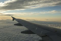 Aircraft wing over the clouds Stock Photo