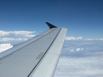Wing of aircraft. In clouds Royalty Free Stock Photo