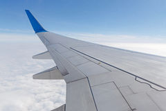 Wing of aircraft. Above clouds Royalty Free Stock Photos