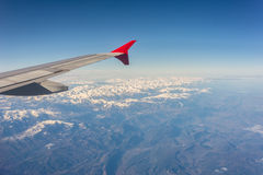 Wing from Aircraft above the snowy Pyrenees Stock Image