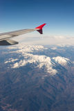 Wing from Aircraft above the snowy Pyrenees Stock Photos