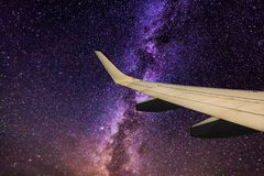 Wing aircraft against a background of the Milky Way. View from the window Stock Photo