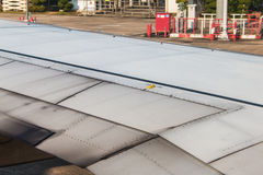 Wing aircraft in airport waiting for takeoff Royalty Free Stock Images