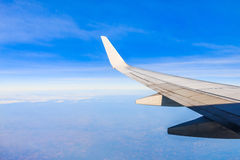 Wing aircraft in altitude during flight Stock Photography