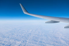 Wing aircraft in altitude during flight Royalty Free Stock Image