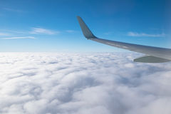 Wing aircraft in altitude during flight Royalty Free Stock Photography