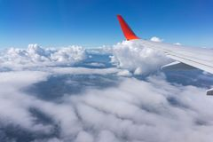 The wing aircraft in altitude during flight over the cloud. stock photo