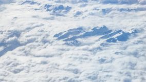 The wing aircraft in altitude during flight. Clouds mountains Royalty Free Stock Images