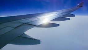The wing aircraft in altitude during flight. Clouds mountains Stock Image
