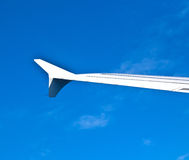 Wing of aircraft in blue sky Royalty Free Stock Photo