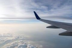 Wing aircraft at cloud sunset Royalty Free Stock Image
