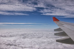 Wing aircraft clouds Stock Images
