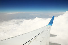 Wing aircraft and clouds Stock Photography