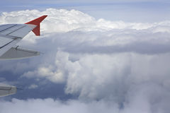 Wing aircraft and cumulus clouds in the sky above Stock Photo