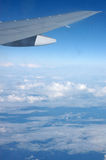Wing of aircraft in flight Stock Images