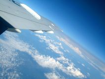 Wing of aircraft in flight Stock Image