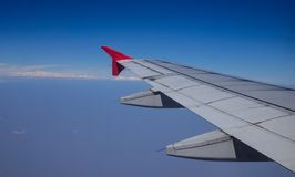 Wing of aircraft in the sky Royalty Free Stock Photography