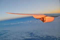 Wing of a aircraft with jet engine royalty free stock photos