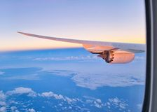 Wing of a aircraft with jet engine royalty free stock photography