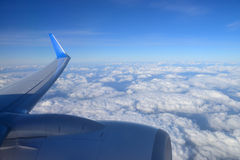 Wing aircraft over clouds Royalty Free Stock Images