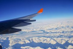 Wing aircraft over the mountains of Greenland royalty free stock photo