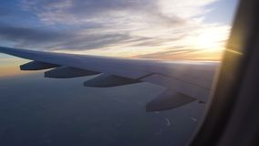 The wing of the aircraft in the setting sun. air travel, travel to other countries, aviation and transportation of.  stock video footage