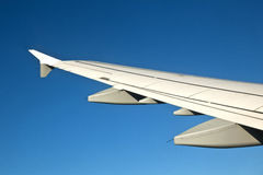 Wing of aircraft in the sky Royalty Free Stock Photos