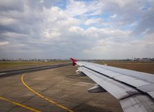 Wing of aircraft in the sky Royalty Free Stock Photo