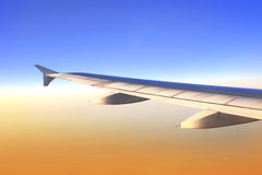 Wing of aircraft in sunrise light Royalty Free Stock Photo
