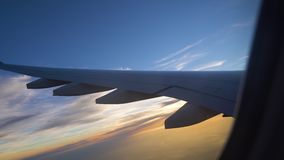 The wing of the aircraft at sunset. air transportation and travel. aviation.  stock video footage