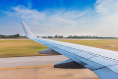 Wing aircraft in takeoff with high speed Royalty Free Stock Images