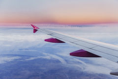 Wing aircraft and a view of cumulus clouds Stock Photo
