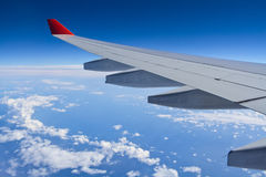 Wing aircraft from the window of an airplane. Stock Image