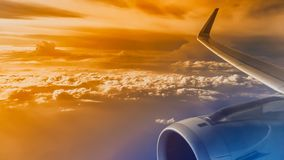 Airplane, Commercial Airplane, Flying, Air Vehicle, European Alp. Wing of an airliner plane in flight. Blue sky. A wing of a passenger jet airbus. During the stock image