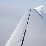 Wing of an airoplane. Seen from above stock photography