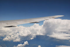 Wing of an airplane. The wing of an airplane seen from the window Royalty Free Stock Photo