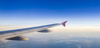 Wing of airplane Stock Photo