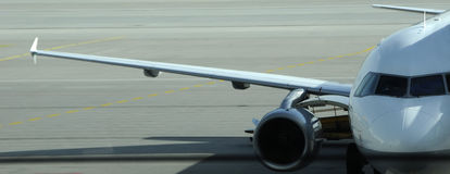 Wing of the airplane Stock Photo