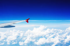 Wing of an airplane above the clouds Stock Photography